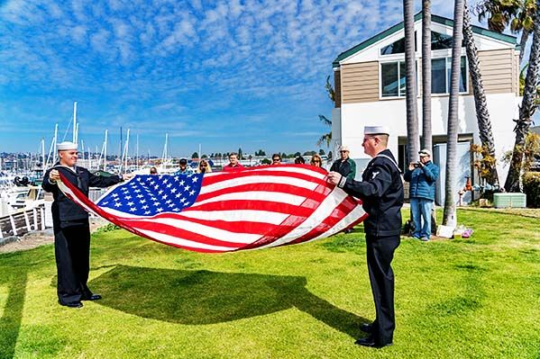 Flag being folded before sea burial