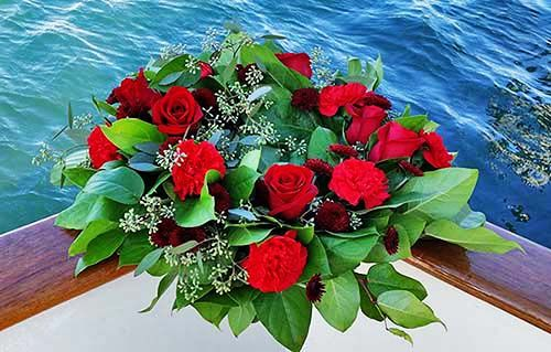 Wreath red rose for sea burial